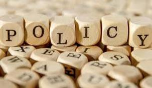 Image of wooden tiles that spell the word policy